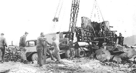 3-inch Anti-Aircraft guns being placed on the causway