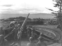 Preparing to fire one of the 155mm guns on Makhnati Island