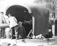 Some men preparing to instal the barrel in a 6-inch gun